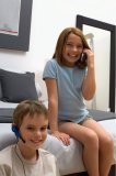 Portrait of two young kids on the telephone.