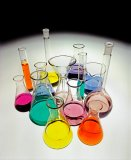 Chemical flasks and coloured liquids.